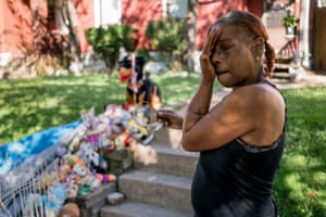 Tracy Wafford wipes away tears as she stands next to a memorial for her three-year-old granddaughter, Kennedi Powell, outside her house in south St Louis on 13 September 2019.