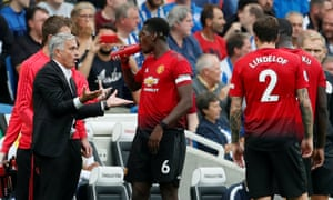 José Mourinho talks with Paul Pogba during Manchester United's 3-2 defeat by Brighton.