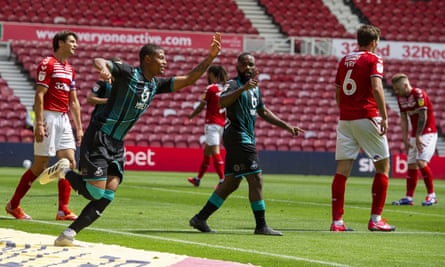 Middlesbrough players are dejected as Rhian Brewster celebrates scoring Swansea's first goal