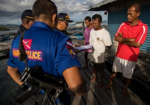 Police and WCS interview staff at the holding facility, Kasumba Island, Indonesia.