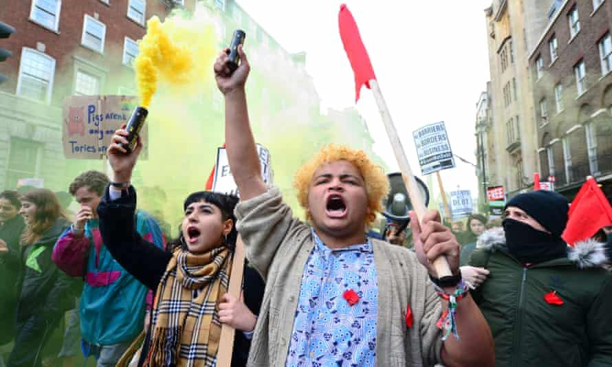 Students during a protest calling for the abolition of tuition fees and an end to student debt in Whitehall, London.