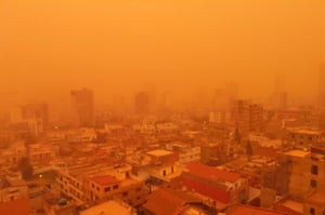 Oran, Algeria: The port city engulfed in a yellow cloud of dust during a sand storm.