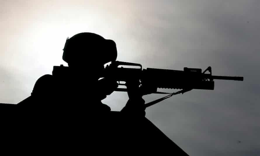 silhouette of a soldier with a gun