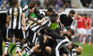 Newcastle players celebrate after Aston Villa's late equaliser against Brighton gave them the title.