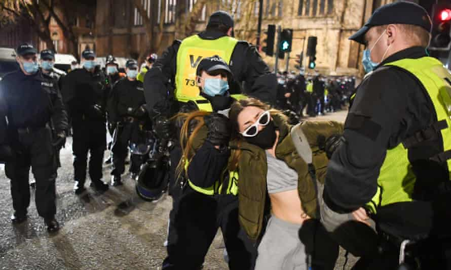 """Police officers and a protester at a """"kill the bill"""" demonstration in Bristol on Saturday."""