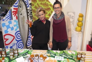 Good writer Adriana Freire, left, sells jam made from the city's fruit trees on her Muita Fruita stall in Lisbon