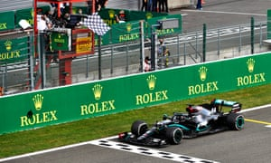 Lewis Hamilton takes his Mercedes across the finish line to win during the Belgian Grand Prix at Spa-Francorchamps.
