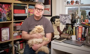 Mark Kermode and his cat Harry in his office at home.