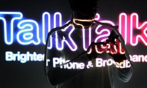 TalkTalk logo behind a person using a phone