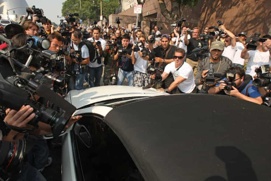 Mobbed … photographers surround Britney's car as she arrives at court in 2007.
