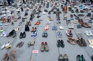 The place de la République is covered with shoes as part of a symbolic rally during the forbidden COP21 demonstration in Paris, France