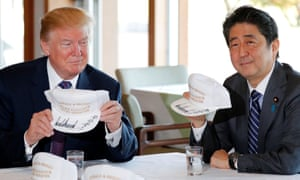 """U.S. President Donald Trump and Japan's Prime Minister Shinzo Abe hold hats they signed before lunch and a round of golf at Kasumigaseki Country Club in Kawagoe, JapanU.S. President Donald Trump and Japan's Prime Minister Shinzo Abe hold hats they signed, reading """"Donald & Shinzo Make Alliance Even Greater"""" before lunch and a round of golf at Kasumigaseki Country Club in Kawagoe, Japan November 5, 2017. REUTERS/Jonathan Ernst"""