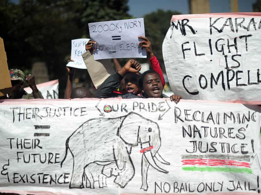 Conservation activists demonstrate during the trial of Feisal Mohamed Ali.