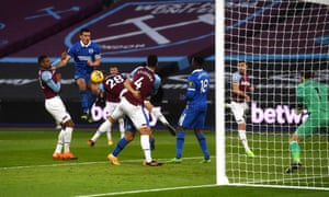 Lewis Dunk of Brighton & Hove Albion wins possession of the ball in the box and scores.