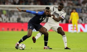France's Paul Pogba tussles with Germany's Antonio Rüdiger.