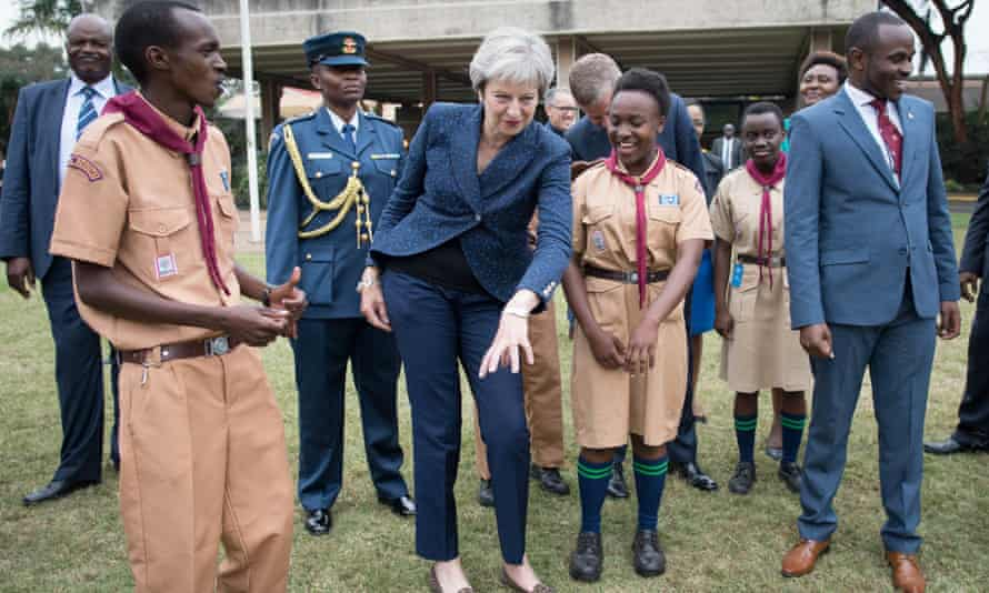 In Britain's interests? Theresa May breaks into dance during a meeting with scouts in Nairobi last week