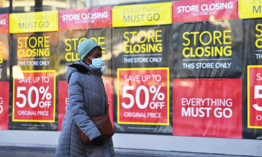 A woman walks past a closing down sign in Birmingham, in January 2021