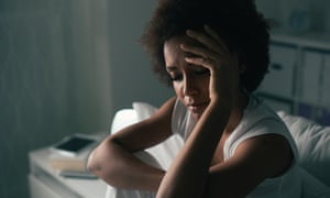 A woman is seen suffering from insomnia