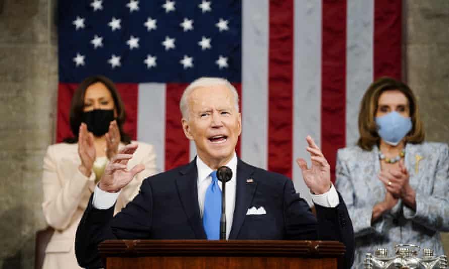 Joe Biden addresses Congress with Kamala Harris and Nancy Pelosi in the background