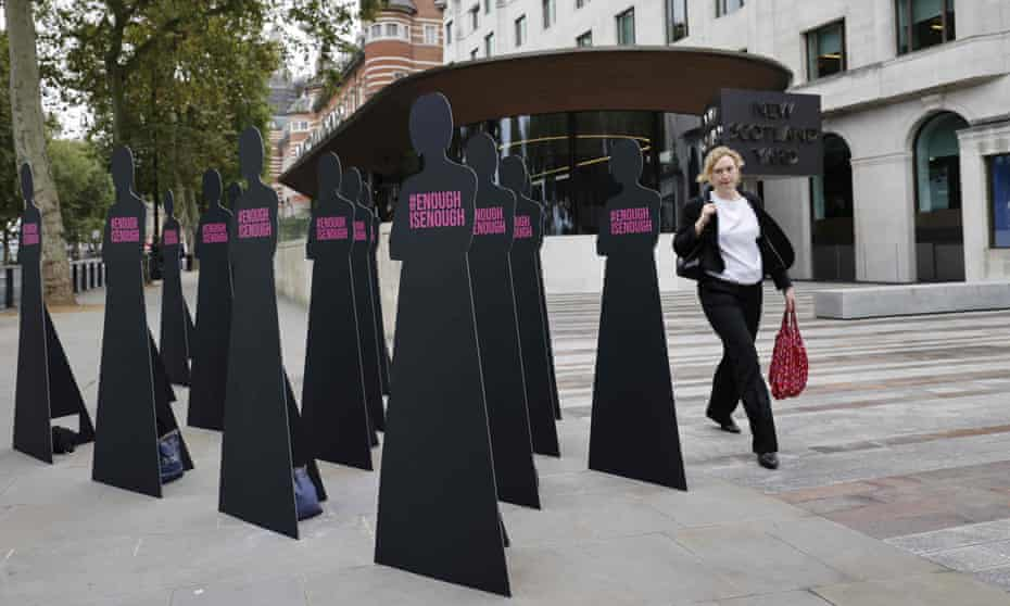 Cut-out silhouettes representing women set up outside the Metropolitan police headquarters in London by the domestic abuse charity Refuge