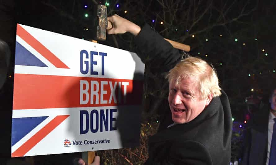 Boris Johnson puts up a Get Brexit Done sign, 11 December 2019.