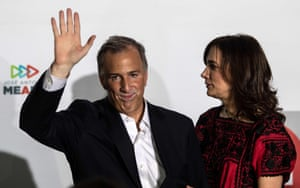 The candidate for the Todos por Mexico (All for Mexico) coalition, José Antonio Meade, stands alongside his wife, Juana Cuevas, during a news conference