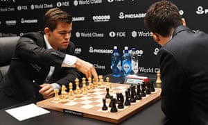 Reigning champion Magnus Carlsen (left) at the most recent World Chess Championships in London in 2018