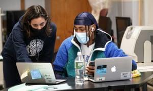 Instructor Chaya Baras, left, helps student Kenny Scottborough, 19, at West Brooklyn community high school, Thursday, 29 October 2020.