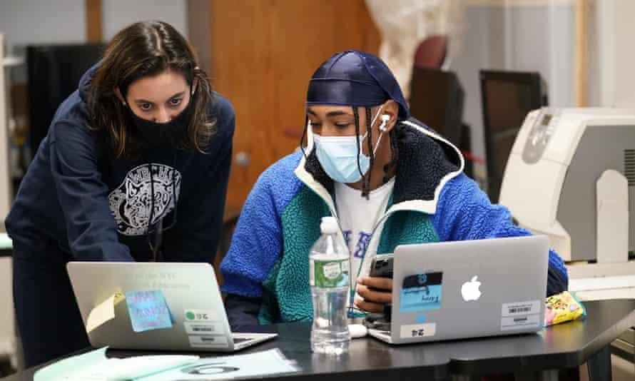Instructor Chaya Baras helps student Kenny Scottborough, 19, at West Brooklyn community high school.