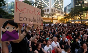 People attend a Hong Kong rally in support of demonstrators protesting against the proposed extradition bill.