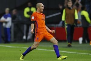 Arjen Robben celebrates after scoring a superb second.
