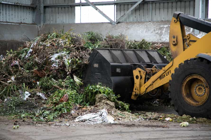 A front end loader is used to feed the organics into the system. From there it travels up a conveyor into a sorting cabin where non-compostable and contaminated material has to be removed.
