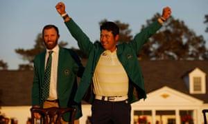 Hideki Matsuyama celebrates with his green jacket, presented to him by previous winner Dustin Johnson.