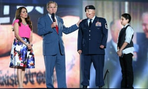 George W Bush on stage with Israel Del Toro and his family during the Opening Ceremony of the Invictus Games in Orlando, Florida.