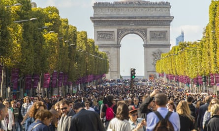 Thronged crowds enjoy the car ban at the Champs Elysées.