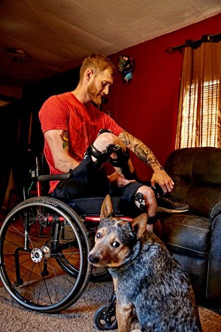 Dewey and his dog at home.