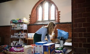 A volunteer at Wandsworth food bank in south London makes up food parcels from donations.