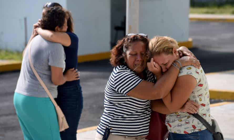 Relatives and friends of victims embrace each other outside the general prosecutor's office in Veracruz, on 28 August.