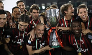 Milan's players pose with the trophy after the shootout win over Juventus