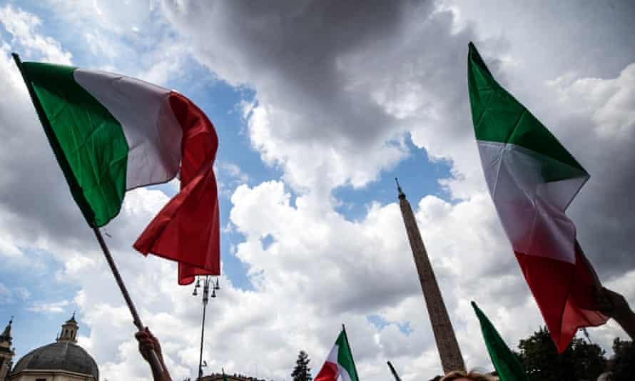 People wave Italian national flags at a joint rally staged by Italy's three main rightwing parties, Lega, Brothers of Italy and Forza Italia, last year
