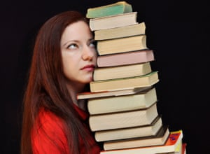 Woman holding a pile of books