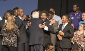 Bernie Sanders and Dr Cornel West share a hug following Sanders' speech at the historic black Benedict college in Columbia, South Carolina.