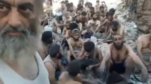 A still from a video showing Islamic State militants who surrendered in Mosul's old city on 13 July.