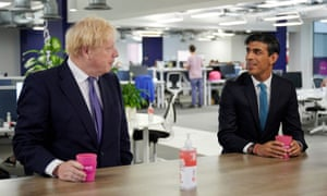 Britain's prime minister Boris Johnson and chancellor of the exchequer Rishi Sunak visit the headquarters of Octopus Energy in London on Monday.