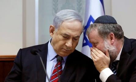 Avichai Mandelblit talks into Benjamin Netanyahu ear
