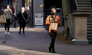 A shopper wears a face mask in Nottingham.