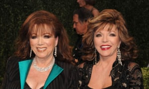 With sister Joan Collins in 2009.