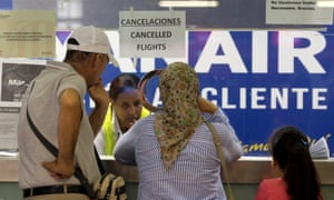 A cancellation notice greets passengers at the Ryanair desk at Barcelona's El Prat airport during a cabin crew strike.