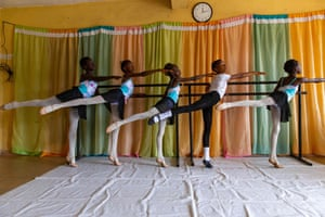Students stretch during rehearsals