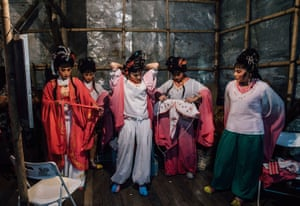 Performers prepare backstage at a Chinese opera